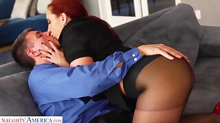 Bright red haired woman Kelly Astronomical gets her pussy fucked in ripped pantyhose