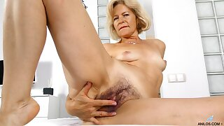 Diana Gold teases her hairy pussy with her sex toy like never before