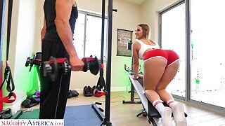Kenzie Madison doing Romanian deadlifts and object laud up ahead gym