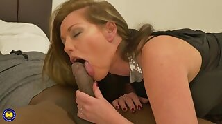 Holly Kiss and a handsome, coal-black man are fucking in front of a hidden camera